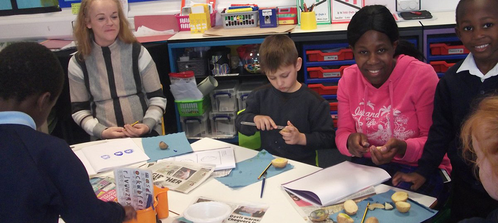 Year 1 made potato prints with parents and carers